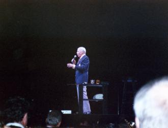 Frank Sinatra Munich 1990 (pic taken from JP orchestra-seat).  Sensational European tour played to packed houses like this 12,000-seater sports-hall in Munich. Orchestra of  London and American players was conducted by Frank Sinatra Jnr.