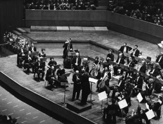 JP with the London Mozart Players at a concert at the Royal Festival Hall in 1970, with conductor Harry Blech congratulating legendary bassoon-player Archie Camden on his 80th birthday. JP and 2nd horn Peter Clack mid-back-right behind woodwinds.