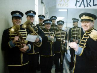 """Poirot"" filming for ITV 1998 (JP front L with tenor horn). We were "" Farley's Pork Pies"" works-band filming near Teddington at the Hampton Road Waterworks Primary Filter Plant (play the horn and see the world!) with composer Chris Gunning ( front right)."