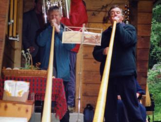 Swiss post-concert party at the Jones' chalet included alp-horn trios played by (L-R) Frank Lloyd, James Gourlay (tuba), JP as Philip's ashes were scattered in the surrounding meadow.