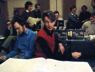 Philip Jones Brass Ensemble recording-sessions 1983. Philip Jones (centre), legendary tuba-player John Fletcher(left), JP(behind them holding music) and other PJBE players listening to play-backs. Sessions took place at the old Kingsway Hall in Holborn.